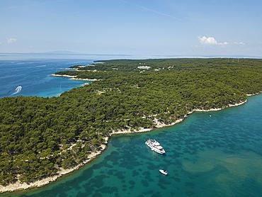 Aerial view of cruise ship in pristine bay at a swim stop for passengers, near Rab, Primorje-Gorski Kotar, Croatia, Europe