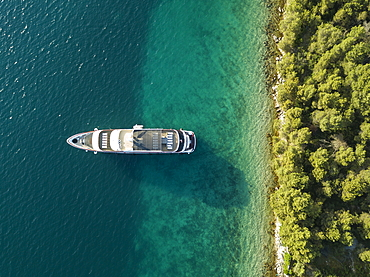 Aerial view of cruise ship in pristine bay at a swim stop for passengers, near Kukljica, Zadar, Croatia, Europe