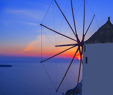 Wndmill at sunset, Oia, Santorini, Cyclades Islands, Greece
