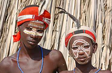 Ethiopia; Southern Nations Region; southern Ethiopian highlands; two boys of the Arbore people; with with headdress and face painting; Arbore tribal area between Turmi and the village of Arbore