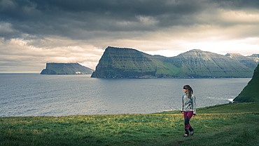 Woman hiking on Kalsoy Island, Faroe Islands