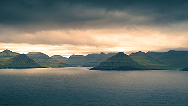 Sunset over the mountains of the coast of Eysteroy, Faroe Islands