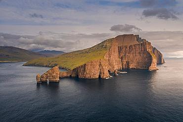 Rock formations of Drangarnier and Vagar Island in sunset, Faroe Islands