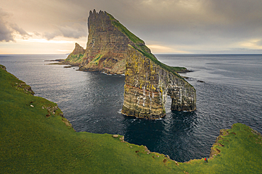 Drangarnier rock formations and Tindholmur island in sunset on Vagar, Faroe Islands