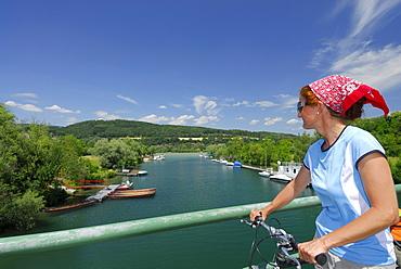 Female cyclist on bridge over river Erlauf, Danube Cycle Route Passau Vienna, Poechlarn, Wachau, Lower Austria, Austria