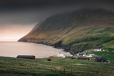 Viðareiði village with seaside church on Vidoy island, Faroe Islands
