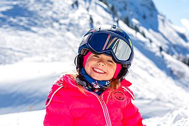 Child having fun in the snow in St. Johann in Tirol, St. Johann, Tirol, Austria