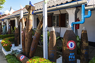 Cartridge casings from unexploded ordnance that fell on Laos during the 2nd Indochina War in the 1970s are exhibited in front of the UXO Laos Information Center, Luang Prabang, Luang Prabang Province, Laos, Asia