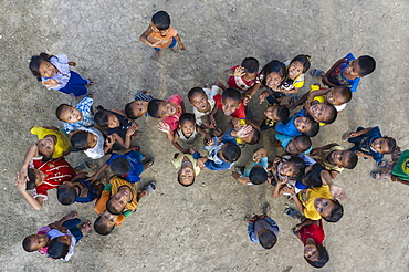 Aerial view of school children in front of ATCA School in Donemisay Village supported by funds provided by Lernidee Adventure Travel, Ban Pak Tha, Pak Tha District, Bokeo Province, Laos, Asia