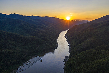 Aerial view of river cruise ship Mekong Sun on the sandy bank of the Mekong with mountains at sunset, Ban Hoy Palam, Pak Tha District, Bokeo Province, Laos, Asia and mountains at sunset, Hongsa, Oudomxay Province, Laos, moored Asia