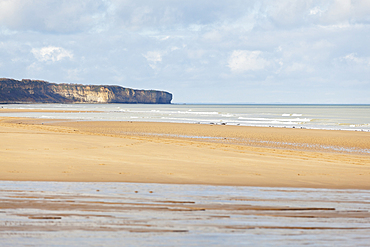 The landing beach of Omaha Beach, Lower Normandy on a sunny winter day.