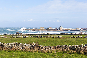 The port of Goury on the Cotentin Peninsula, Normandy, France in a storm. Old stone walls in the foreground.