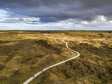 Aerial view of two cyclists on hiking and cycling path through the dunes of Westerduinen, near Den Hoorn, Texel, West Frisian Islands, Friesland, Netherlands, Europe