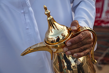Detail of a coffee pot during an Arab coffee ceremony at a local festival, near Al Ain, Abu Dhabi, United Arab Emirates, Middle East