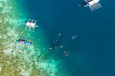Aerial view of guests enjoying a snorkeling trip at the Skeleton Wreck shipwreck off Coron Island, Banuang Daan, Coron, Palawan, Philippines, Asia