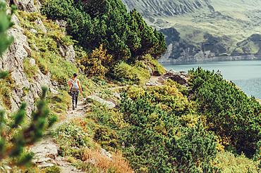 Woman hiking on Lünersee, Vorarlberg, Austria, Europe