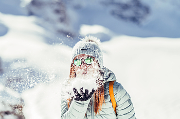 Woman is happy in the snow, Diavolezza, Upper Engadin, Grisons, Switzerland, Europe