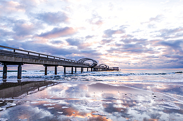 Morning mood with reflection of the pier in Kellenhusen Baltic Sea, Ostholstein, Schleswig-Holstein, Germany