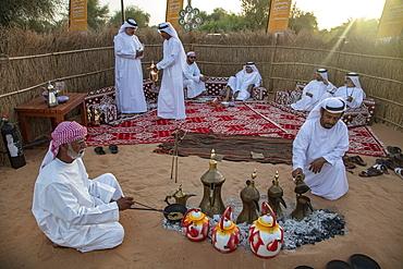 Arab coffee ceremony at a local festival, near Al Ain, Abu Dhabi, United Arab Emirates, Middle East