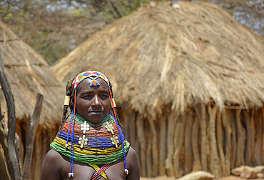 Angola; Huila Province; small village near Chibia; Muhila woman with traditional head and neck jewelry; ornate pearl jewelry in the hair; massive choker made of pearls and earth