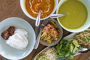 A delicious lunch is served on board river cruise ship on Tonle Sap River, Kampong Chhnang, Cambodia, Asia