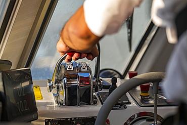Hand on accelerator of tender boat from expedition cruise ship World Explorer (nicko cruises), Punta del Este, Maldonado Department, Uruguay, South America