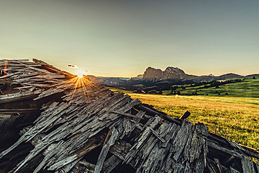 broken hut at sunrise on the Seiser Alm in South Tyrol, Italy, Europe;