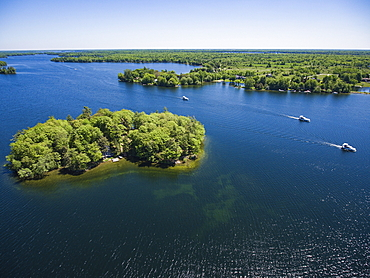 Aerial view of island and three Le Boat Horizon houseboats, Big Rideau Lake, Ontario, Canada, North America