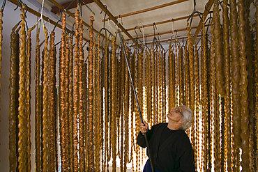 Soudzoukos, almond sweets, production, Moutoullas, Troodos mountains, Cyprus