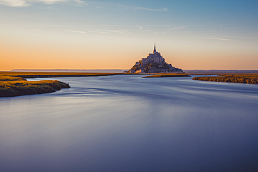Evening view of the rocky island of Mont Saint Michel with the monastery of the same name, Normandy, France.