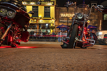 Low view of motorcycles and bars in the trendy ByWard Market neighborhood at night, Ottawa, Ontario, Canada, North America