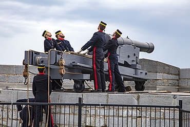 Firing historic cannons at Fort Henry Historic Site and Museum of Living History with uniformed performers known as the Fort Henry Guard performing British military life demonstrations and tours for visitors, Kingston, Ontario, Canada, North America