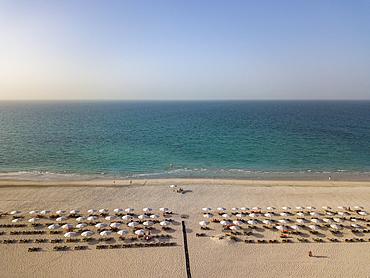 Aerial of beach chairs and umbrellas of Saadiyat Rotana Resort & Villas and sea, Saadiyat Island, Abu Dhabi, United Arab Emirates, Middle East