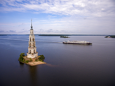Aerial view of the river cruise ship Excellence Katharina (formerly MS General Lavrinenkov) while passing the Kalyazin bell tower in the Volga river (which is all that is left of the old town of Kalyazin after the Uglich reservoir was flooded), Kalyazin,