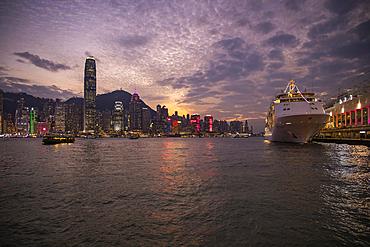 Cruise ship Silver Shadow at the Hong Kong Cruise Terminal with city skyline at sunset, Hong Kong, Hong Kong, China, Asia