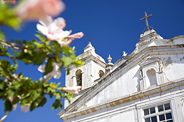 Santo Antonio Church with almond blossoms, Lagos, Algarve, Portugal
