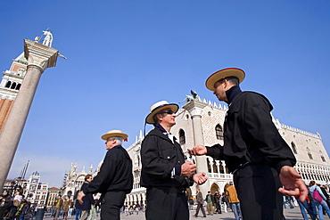 Gondoliers near the Doges Palace, Piazza San Marco, Venice, Veneto, Italy