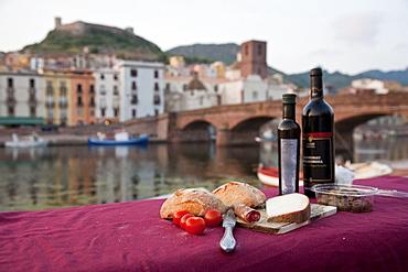 Picnic at the river Fiume Temo with view to the Castello di Serravalle, Bosa, Sardinia, Italy, Europe