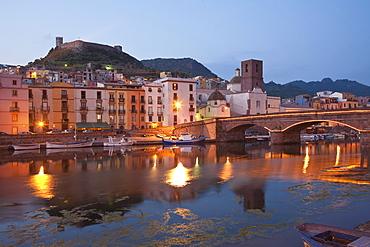 Bridge above the river Fiume Temo and the Castello di Serravalle at dusk, Bosa, Sardinia, Italy, Europe