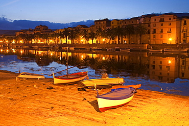 Boats, dusk, view at the city houses, river Fiume Temo, Bosa, Sardinia, Italy, Europe