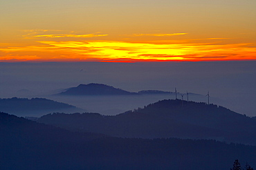 View from the mountain Kandel over the Black Forest with wind energy plants on the Rosskopf, Winter, Sunset, Baden-Wuerttemberg, Germany, Europe