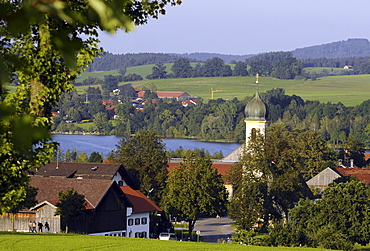 View over Froschhausen with Sankt Leonhard church at lake Riegsee, Bavaria, Germany