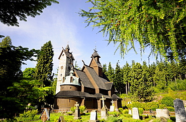 Stave church Wang and graveyard in the sunlight, Karpacz, Bohemian mountains, lower-Silesia, Poland, Europe