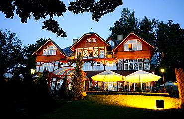 View at the illuminated Hotel Rezydencia Karpacz in the evening, Karpacz, Bohemian mountains, lower-Silesia, Poland, Europe