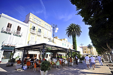 People at a sidewalk cafe at the town Carloforte, Isola di San Pietro, South Sardinia, Italy, Europe