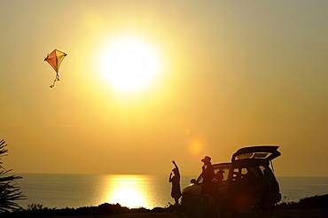 Kiteflying at Capo Sandalo at sunset, Isola di San Pietro, South Sardinia, Italy, Europe