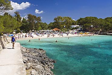 People on the beach in the bay calÛ d'en Garrot, Cala MondragÛ, Mallorca, Balearic Islands, Mediterranean Sea, Spain, Europe