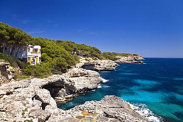Cliffs in the bay Cala MondragÛ under blue sky, natural park of MondragÛ, Mallorca, Balearic Islands, Mediterranean Sea, Spain, Europe