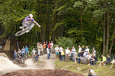 Teenager jumping a tabeltop with dirt bike, Starnberg, Bavaria, Germany
