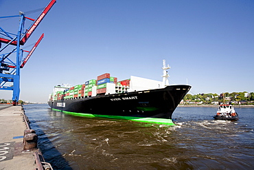 Container ship landing at pier, Port of Hamburg, Germany